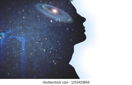 The universe within. Silhouette of a man with the space as a brain. The concept on scientific and philosophical topics.  Elements of this image furnished by NASA.