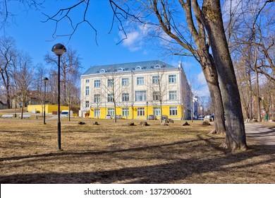 University building seen across public park in Tartu, Estonia