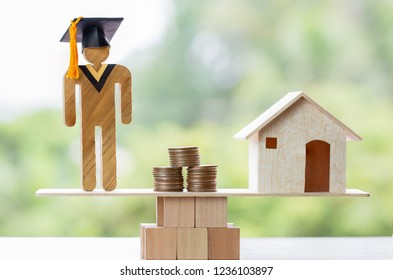University Education learning abroad international Ideas. Student Graduation, coins and house on wood balance. Concept of study requires money cost saving, may be home loan, transform propery to cash.