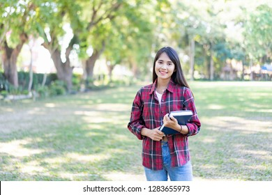 University Education learning abroad international ,Young students asian teenager smile with Note book, school folders reading book at high school university campus college  study learning in summer