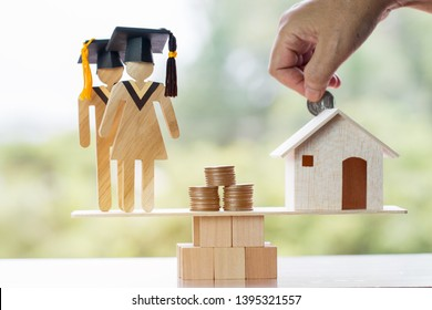 University Education learning abroad international Idea. Student Graduation save coins in house on wood balance. Concept of study requires money cost saving, may be home loan transform propery to cash