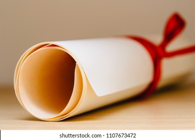 University Graduation Diploma With Red Ribbon