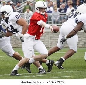 UNIVERSITY PARK, PA - APRIL 24: Penn State quarterback Matthew McGloin hands the football off at Beaver Stadium April 24, 2010 in University Park, PA