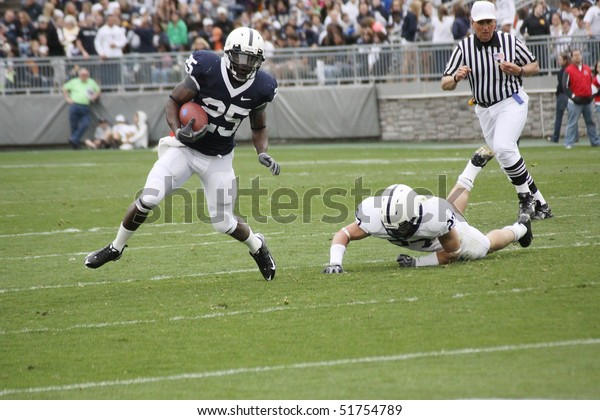 UNIVERSITY PARK, PA - APRIL 24: Penn State running back Silas Redd breaks a tackle  at Beaver Stadium April 24, 2010 in University Park, PA