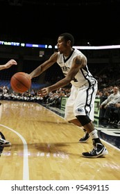 UNIVERSITY PARK, PA - FEB 16: Penn State's Cameron Woodyard passes the basketball against Iowa at the Byrce Jordan Center February 16, 2012 in University Park, PA