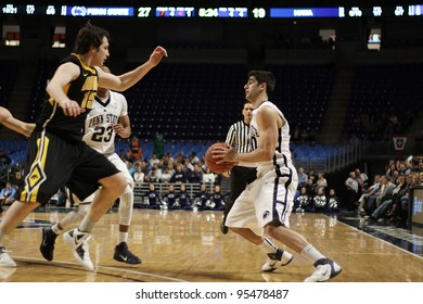 UNIVERSITY PARK, PA - FEB 16: Penn State's Nick Colella uses a ball fake to get pat an Iowa defender at the Byrce Jordan Center February 16, 2012 in University Park, PA