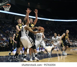 UNIVERSITY PARK, PA - FEB 16: Iowa's defense collapses on Penn State's Jermaine Marshall as he passes the ball during a game at the Byrce Jordan Center on February 16, 2012 in University Park, PA