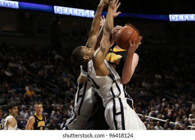 UNIVERSITY PARK, PA - FEB 16: Penn State's Jermaine Marshall #11 and Tim Frazier jump high to block Iowa's Aaron White's shot at the Byrce Jordan Center on February 16, 2012 in University Park, PA