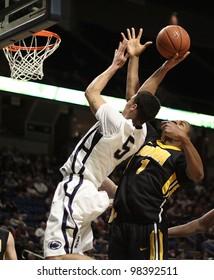 UNIVERSITY PARK, PA - FEB 16: Penn State's Matt Glover jumps high to get his shot off against Iowa at the Byrce Jordan Center on February 16, 2012 in University Park, PA
