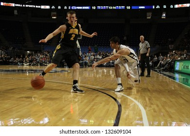 UNIVERSITY PARK, PA -  FEBRUARY 16: Penn State's Nick Colella No. 20 passes around an Iowa defender during a game  at the Byrce Jordan Center February 16, 2012 in University Park, PA