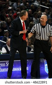 UNIVERSITY PARK, PA - FEBRUARY 24: Ohio State Coach Thad Motta chats with a referee during a game against Penn State at the Byrce Jordan Center February 24, 2010 in University Park, PA