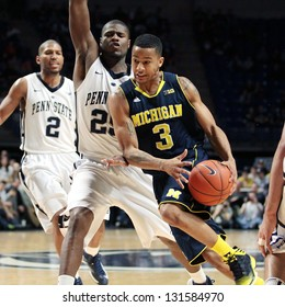 UNIVERSITY PARK, PA - FEBRUARY 27: Michigan's Trey Burke No. 3 drives to the basket against Penn State at the Byrce Jordan Center February 27, 2013 in University Park, PA