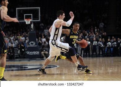 UNIVERSITY PARK, PA -  FEBRUARY 27: Michigan's No. 3 Trey Burke drives to the basket against Penn State n at the Byrce Jordan Center February 27, 2013 in University Park, PA