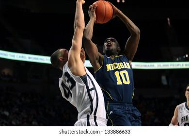 UNIVERSITY PARK, PA - FEBRUARY 27: Michigan's Tim Hardaway Jr. drives to the basket against Penn State at the Byrce Jordan Center February 27, 2013 in University Park, PA