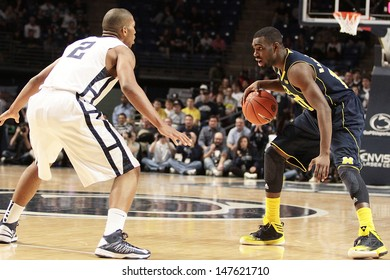 UNIVERSITY PARK, PA - FEBRUARY 27: Michigan's Tim Hardaway brings the ball up the court against Penn State at the Byrce Jordan Center February 27, 2013 in University Park, PA