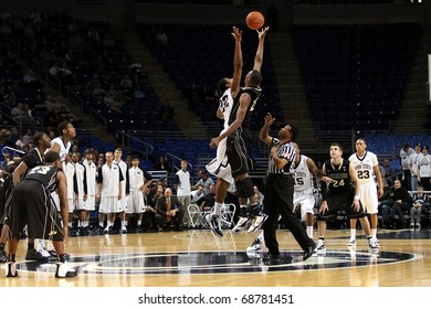 UNIVERSITY PARK, PA - JANUARY 5: Penn State's Andrew Jones and Purdue's JaJuan Johnson jump at mid court at the Byrce Jordan Center January 5, 2011 in University Park, PA