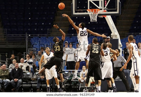 UNIVERSITY PARK, PA - JANUARY 5: Penn State's Andrew Jones blocks Purdue's No. 33 E'Twaun Moore shot at the Byrce Jordan Center on January 5, 2011 in University Park, PA