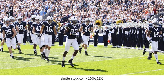 UNIVERSITY PARK, PA - OCT 9: Penn State players take the field before a game against Illinois at Beaver Stadium October 9, 2010 in University Park, PA