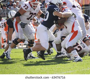 UNIVERSITY PARK, PA - OCT 9: Illinois running back Jason Ford #21 is tackled by Penn State's #33 Michael Yancich at Beaver Stadium October 9, 2010 in University Park, PA