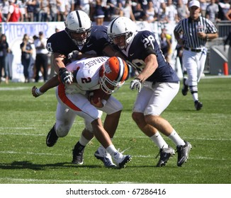 UNIVERSITY PARK, PA - OCT 9:  Illinois quarterback No. 2, Nathan Scheelhaase #2 is tackled by several Penn State players at Beaver Stadium October 9, 2010 in University Park, PA