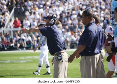 UNIVERSITY PARK, PA - OCT 9: Illinois defensive coaches call out the signals during a game against Penn State at Beaver Stadium on October 9, 2010 in University Park, PA