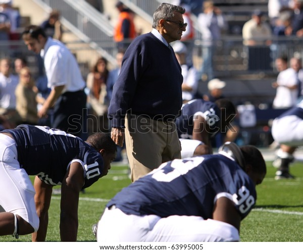 UNIVERSITY PARK, PA - OCT 9: Penn State's coach Joe Paterno watches his players warm up before a game against Illinois at Beaver Stadium October 9, 2010 in University Park, PA