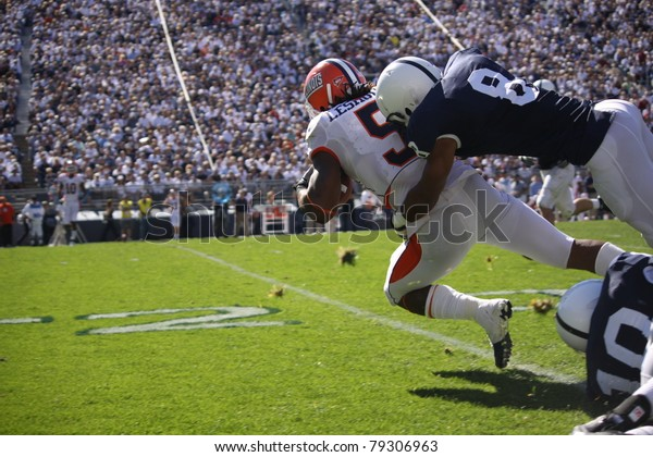 UNIVERSITY PARK, PA - OCT 9: Illinois running back No. 5  Mikel Leshoure is tackled after a long gain during a game against Penn State at Beaver Stadium on October 9, 2010 in University Park, PA