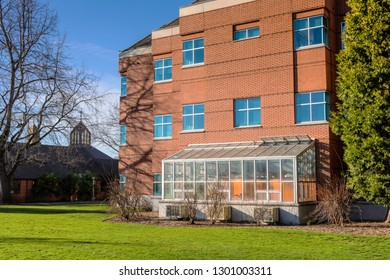 University of Portland building and green house glass enclosure.