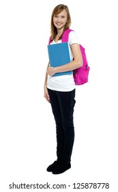 University student carrying pink backpack ready to attend college.
