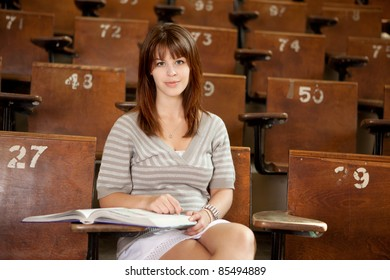 University student in lecture hall, looking at camera