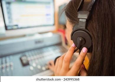 University student mixing audio in a studio of a radio