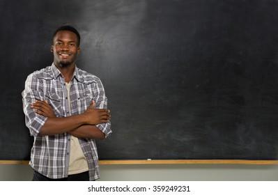 University student posing on blackboard.