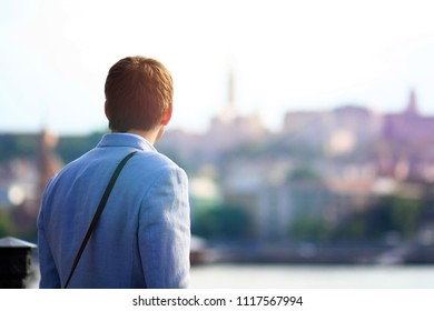University student stands on the streets of Budapest and thinking about future - Shutterstock ID 1117567994