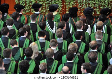 University students attending graduation ceremony in the UK
