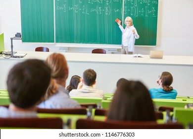 University teacher giving math class in lecture hall