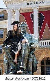 University of Wisconsin graduate celebrates commencement by climbing atop a statue of Abraham Lincoln on the college campus