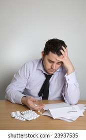 An unkempt man contemplates suicide as he looks at his unpaid bills.