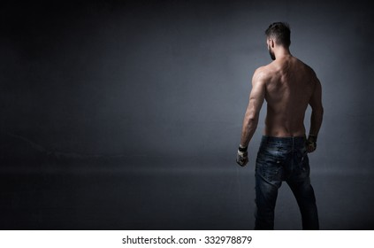 unknow athlete ready for fighting, dark background