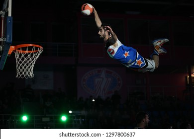 """Unknown basketball player kicks the ball into the basket, Jump high to the rihm. UKRAINE SUPERLEAGUE ALL STAR GAME, Match of the Stars - 2019, 26/01/2019, Palace of Sports """"Youth"""", Zaporozhye, Ukraine"""