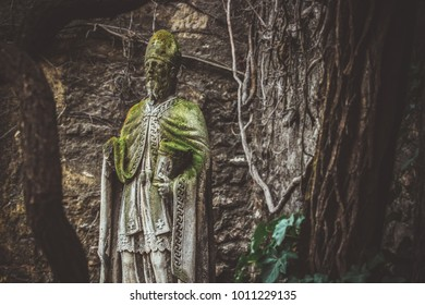 Unknown catholic statue in backwoods of country inside forest
