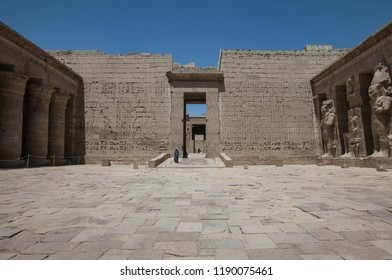 Unknown Egyptian man at entrance of courtyard in Medinet Habu Temple. Luxor, Egypt.