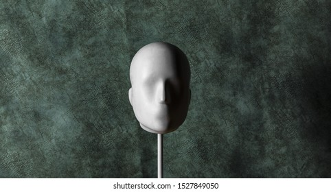 unknown, Faceless mannequin head isolated on dark green background
