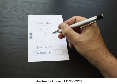 Unknown male fills out a betting slip for Royal Ascot.
