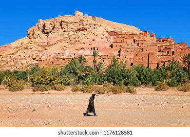 Unknown man walking in front of the beautiful city and ksar of Aït Benhaddou (or Ait Ben-Haddou) (where lots of films were shot), Morocco