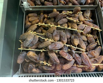 An unknown Muslim shop sells a variety of dates and other dry foods. Image contains certain grain or noise and soft focus.
