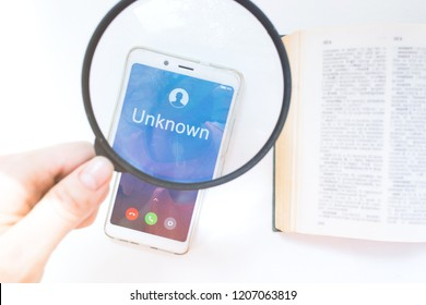 Unknown number calling in the middle. Phone call from stranger. magnifier and zoom mobile phone