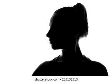 Unknown person. Female person silhouette.Back lit studio isolated