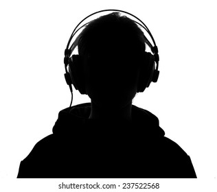 Unknown person in silhouette with headphones over white