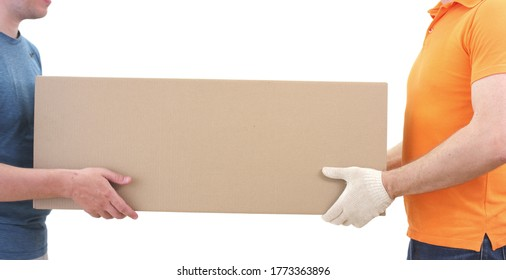 Unknown warehouse worker or courier gives big cardboard parcel to a customer