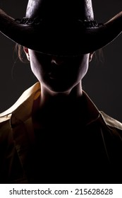 unknown woman with a cowboy hat and face in shadow